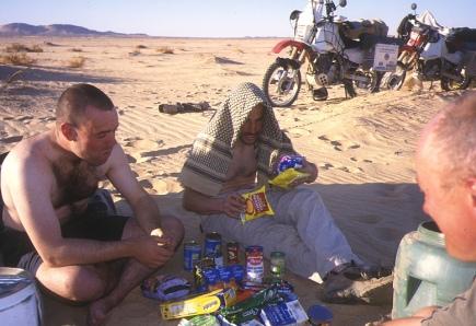 Tucking into the food cache (Erg Killian)